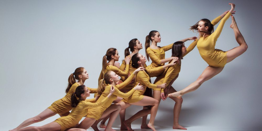 Built By She - The group of modern ballet dancers dancing on gray background